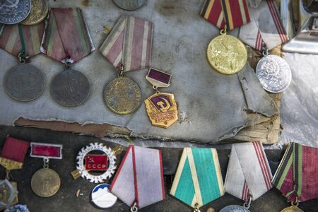 TBILISI, GEORGIA - MAY 3, 2019: Old soviet badges, orders and medals sold on the Dry Bridge Market in Tbilisi, Georgia. It is an everyday open-air flea market.