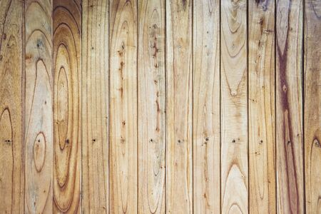 Closeup of the yellow brown fence wall of natural vertical wooden boards Reklamní fotografie