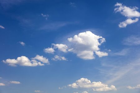 View at white, fluffy clouds in blue sky