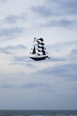 View at black sailing ship kite at a beach near Puna Tanah Lot temple, Bali, Indonesia
