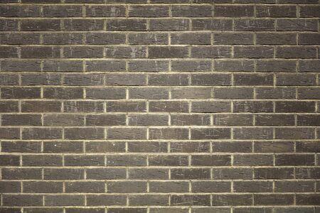 Closeup texture of a dark brick wall