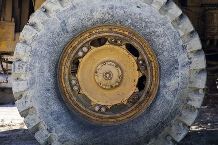 Closeup of the dirty big cargo truck wheel