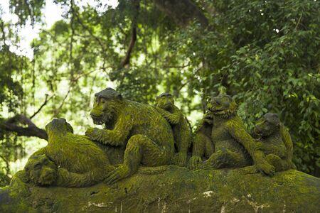 Monkey statue at Ubud Monkey Forest sanctuary at Bali island, Indonesia Stock Photo