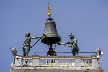 View at Moors striking the hours at the top of the St Mark's Clocktower in Venice, Italy
