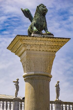 View at sculpture depicting image of lion with wings, symbol of Venice, on the top of the column at San Marco, Italy