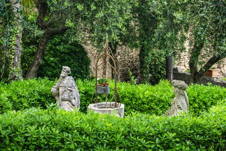 Statues at beautiful garden in Sirmione, a small town on the shores of Lake Garda (Lago di Garda) in Lombardy, Italy