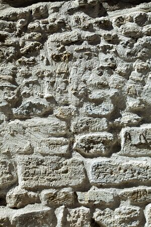 Detail of the white stone wall background texture Banco de Imagens