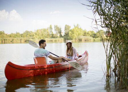 Loving couple rowing on the lake at summer day 版權商用圖片