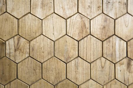 Closeup of the wooden floor in the form of honeycomb