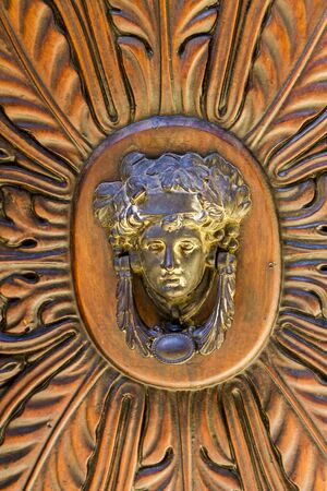 Closeup detail of the vintage door knocker from Montalcino, Italy
