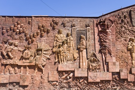 KUTAISI, GEORGIA - APRIL 27, 2019:Detail of the Soviet-era relief on wall of city market in Kutaisi, Georgia. Mosaics and wall sculptures were popular decoration during the Soviet era