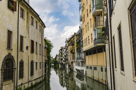 View at water channel San Massimo runs among residential houses in the centre of the old city Padua, Italy Banco de Imagens