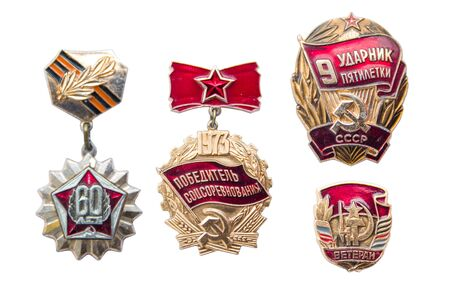 BELGRADE, SERBIA - MAY 10, 2019: USSR labour medals isolated on the white background. They are a civilian labour awards of the Soviet Union bestowed to especially deserving workers.