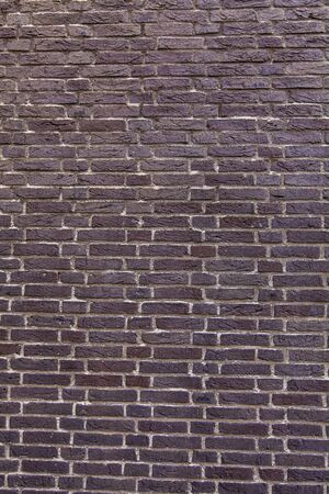 Detail of the old red brick wall