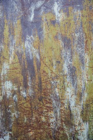 View at old rusty colored metal with cracked paint, grunge background