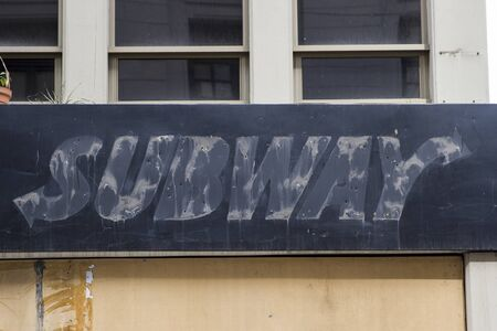 LA PAZ, BOLIVIA - JANUARY 10, 2018: Remains of the Subway restaurant sign in La Paz, Bolivia. It is an American fast food restaurant franchise, founded at 1965. Editorial
