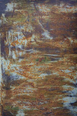 Vue sur le vieux métal de couleur rouillé avec de la peinture craquelée, fond grunge