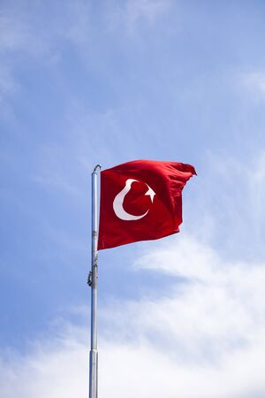 View at Turkish flag waving in the wind at blue sky