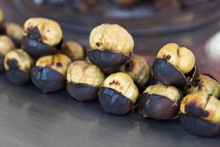 Closeup view at the fresh roasted chesnuts Archivio Fotografico