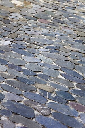 Closeup of the decorative floor pattern of oval stones Stok Fotoğraf - 128818863
