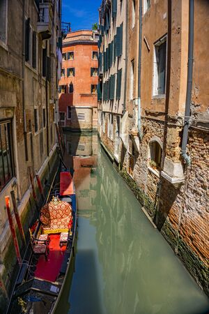 Canal with traditional gondolas in Venice, Italy