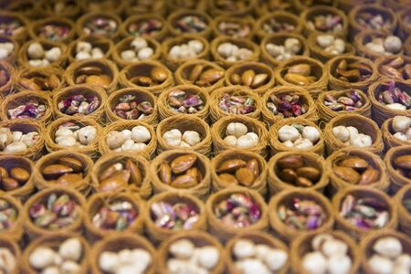 Mixed bird nest baklava with almonds, nuts and pistachios on the Istanbul market Reklamní fotografie - 128822580