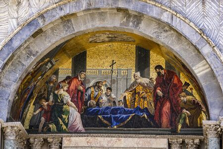 Saint Marks body venerated by the doge mosaic from 1728 at facade of Basilica di San Marco in Venice, Italy
