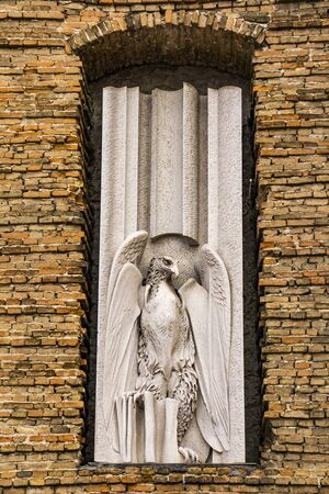 View at eagle, symbol of John the Evangelist, on the facade of  Abbey of St Justina in Padua, Italy.