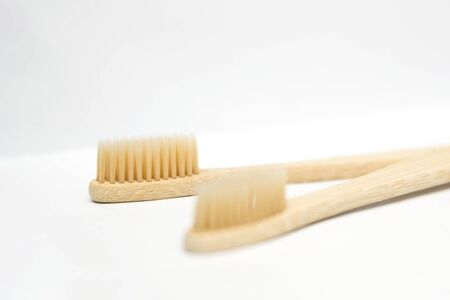 Two bamboo toothbrushes isolated on the white background 写真素材
