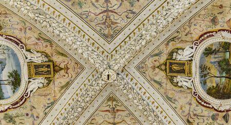 Closeup of the decorative ceilings of  Loggia della Mercanzia in Siena, Italy