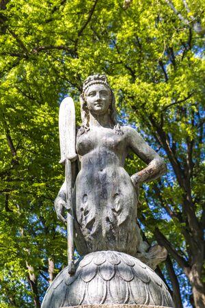 Closeup of the bridge mermaid statue in the park Sempione in Milan, Italy Stock Photo - 129387529