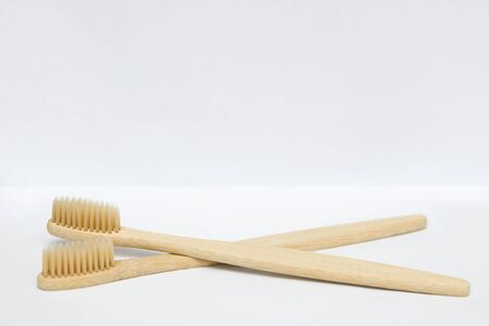 Two bamboo toothbrushes isolated on the white background Stock Photo