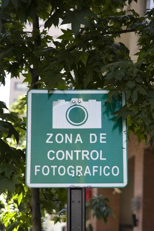 Spanish No Photography Zone sign attached to a post at Santiago de Chile Banco de Imagens
