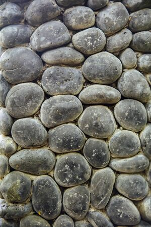Closeup of the round stone wall backdrop