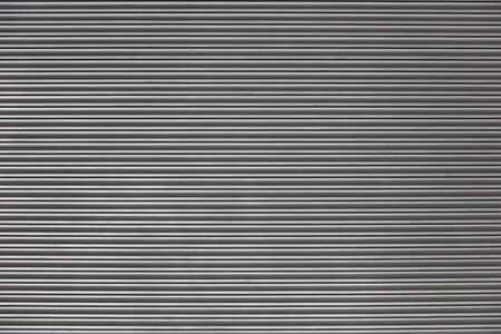 Closeup of grey metal backdrop with horizontal lines Stock fotó