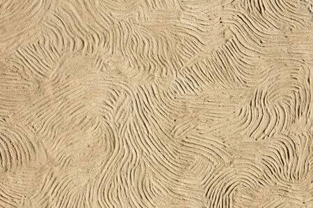 Detail of the beige wavy line facade backdrop