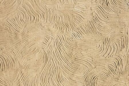 Detalle del telón de fondo de fachada de línea ondulada beige
