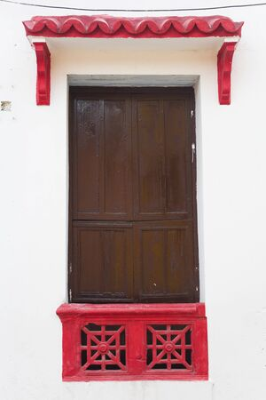 View at typical Latin American colonial window in Cartagena, Colombia