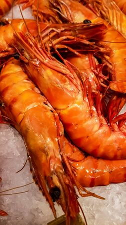 Fresh red prawns at the fish market Stock Photo