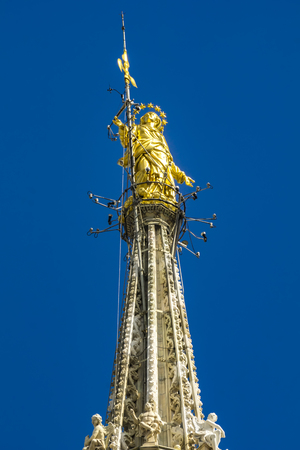 Statue of the Virgin Mary on top of the Milan Cathedral (Duomo di Milano) in Italy
