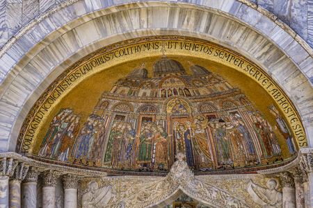 Mosaic of the translation of the body of Saint Mark on San Alipio facade door of the Saint Marks Basilica in Venice, Italy Editorial