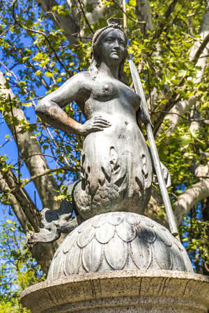 Closeup of the bridge mermaid statue in the park Sempione in Milan, Italy Standard-Bild - 131367345