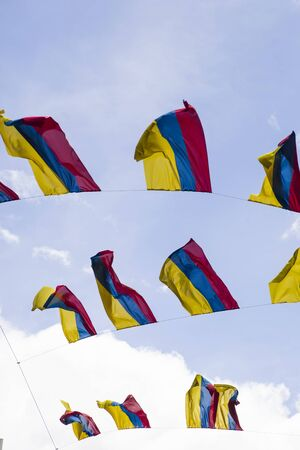 Colobian flags under blue sky in Bogota, Colombia Stock Photo