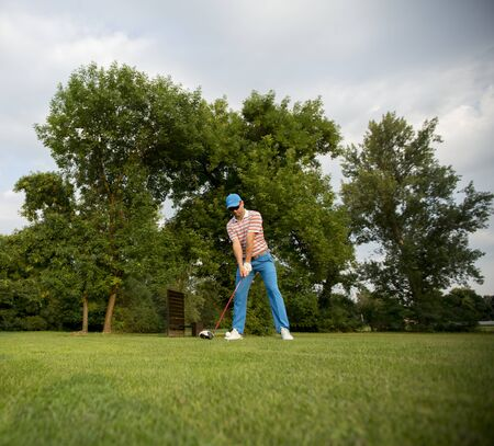 Young man playing on the golf course