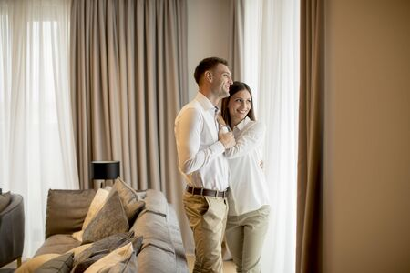 Romantic happy young couple relax at the modern home interior