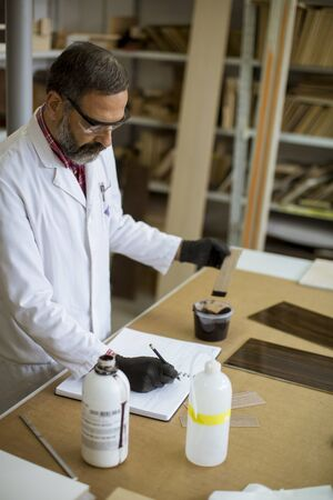 Senior male researcher in a color lab