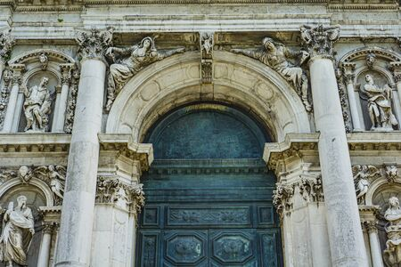 Closeup of the doorway at Cathedral of Santa Maria della Salute in Venice, Italy 報道画像