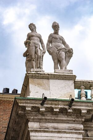 View at statues at Palladian Basilica in Vicenza, Italy