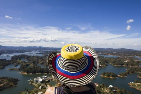 Viewat young woman at Guatape lake in Antioquia, Colombia 写真素材