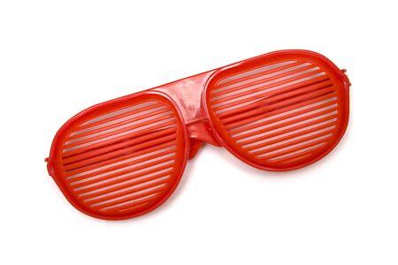Red shutter shading glasses isolated on the white background Banco de Imagens